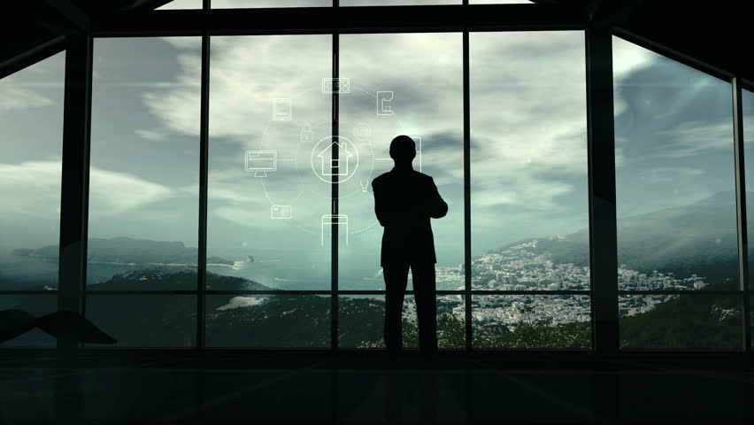 A man is standing by the window viewing IOT infographics elements   Shutterstock HD Video #34777261