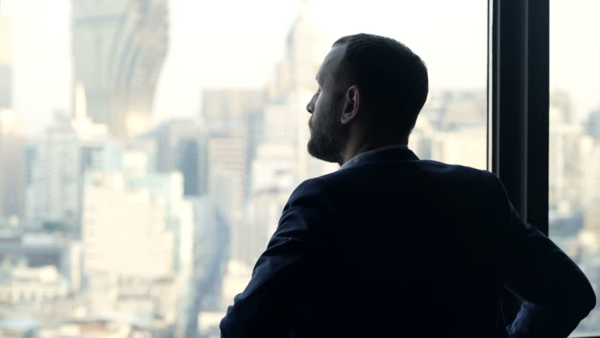 Young businessman admire view standing by window in office  #34791427