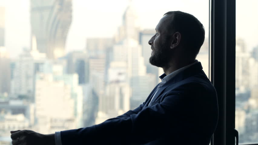 Young businessman admire view standing by window in office  #34791433
