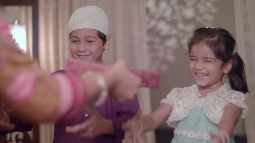 Muslim Children smiling, happy to receive Gifts from Parents on Eid Holidays