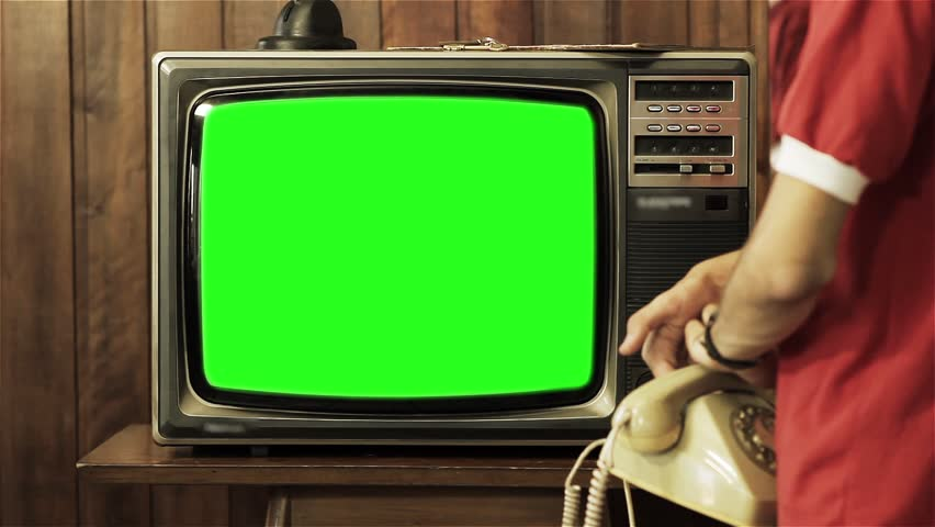 "Teenage Boy Talking on Old Phone and Turning Off Old Television Green Screen. You can Replace Green Screen with the Footage or Picture you Want with ""Keying"" effect in AE  (check out tutorials on YT)."