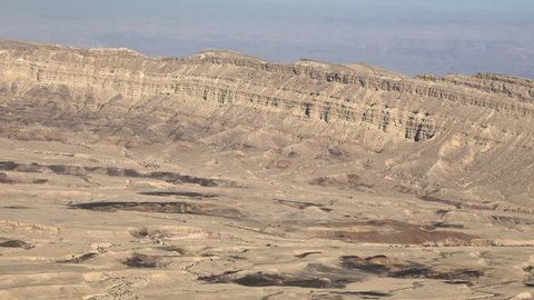 Small(little) makhtesh (crater) or Makhtesh Katan panorama landscape with Dead sea on background. It is geological erosional landform of Israel's Negev desert. It measures 5 x 7 km. Israel