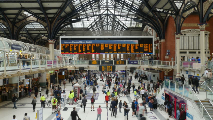Busy Train Station People Travelling Time-Lapse 4K. Ultra HD locked off video time-lapse of people at bust train station in London, England. No recognizable logos or faces.