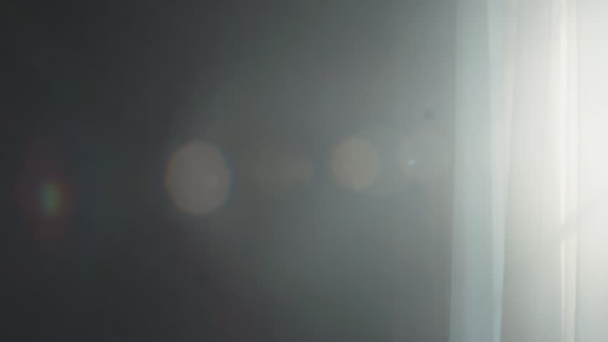 White curtain moving in the deserted dark room. Morning sun lighting the room. Paranormal activity, moody atmosphere, haunted house | Shutterstock HD Video #34859575
