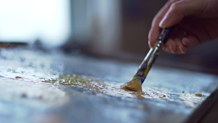 Artist mixes paints on the palette before painting a picture, painter at the studio, creator makes piece of art | Shutterstock HD Video #34881577