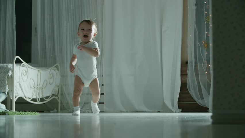 As the baby does the first steps and falls in slow motion, the symbol of the first failure, the motivation | Shutterstock HD Video #34906630