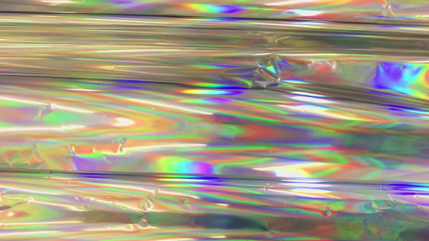 Colorful holographic foil moving and changing reflection and lights. | Shutterstock HD Video #34908397