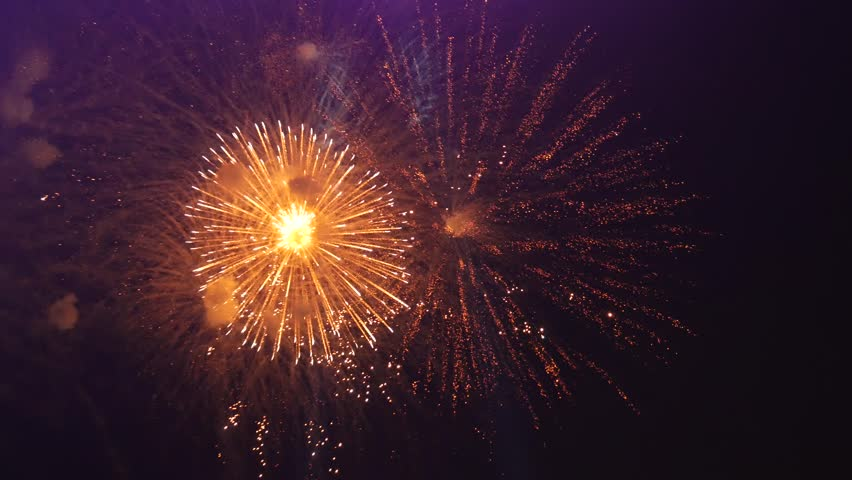 Cluster of colorful fireworks against dark sky | Shutterstock HD Video #34915030
