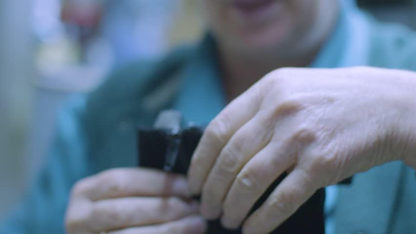 Slow motion detail shot inside a shoe repair shop. Fixing a leather boot zipper | Shutterstock HD Video #34917592