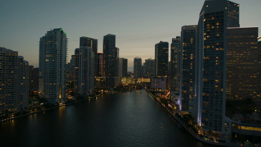 Miami USA - September 2017: Aerial Skyline illuminated cityscape night view of Brickell Key Skyscrapers Miami River downtown Financial Banking district Florida