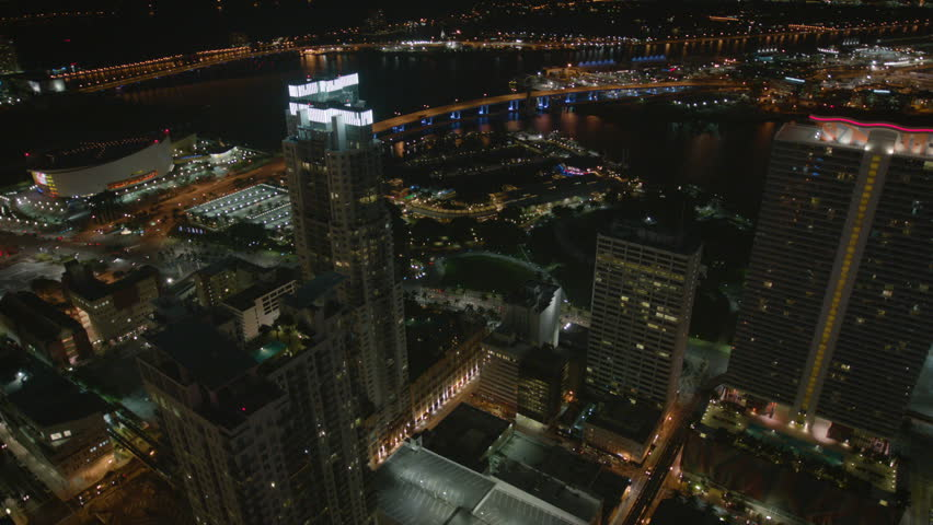 Miami USA - September 2017: Aerial night view of illuminated Skyscrapers Port of Miami downtown American Airlines Arena Bayside Marketplace Biscayne Bay Miami Florida | Shutterstock HD Video #34926097