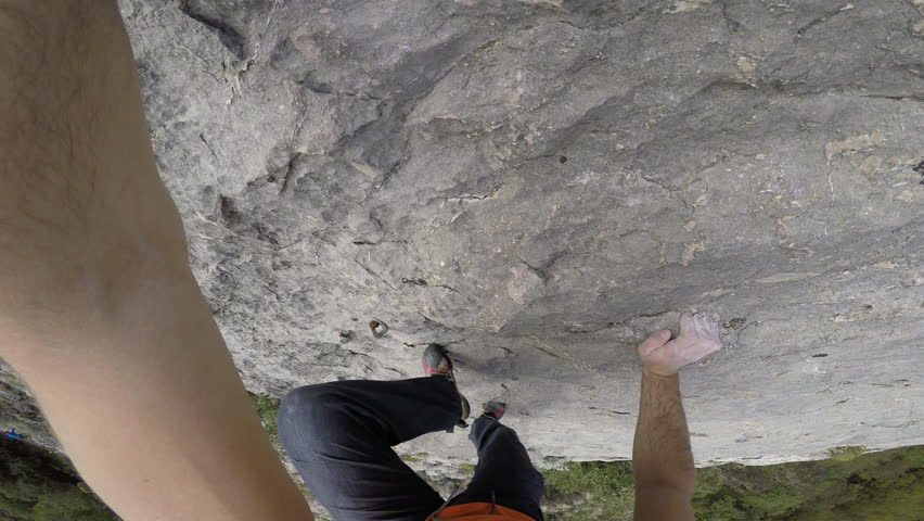 POV close-up of free solo climber with just hands and feet getting grip on the wall. | Shutterstock HD Video #34926595
