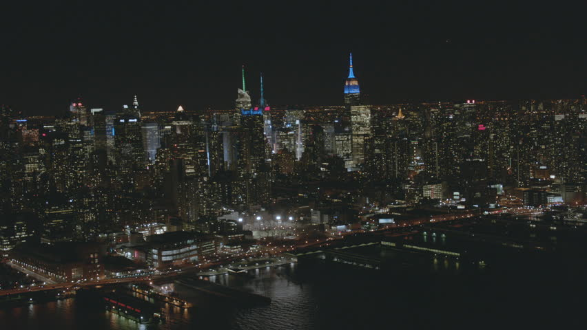 New York USA - September 2017: Aerial night illuminated view of Empire State Building city Skyscrapers Hudson River Midtown Manhattan Skyline America