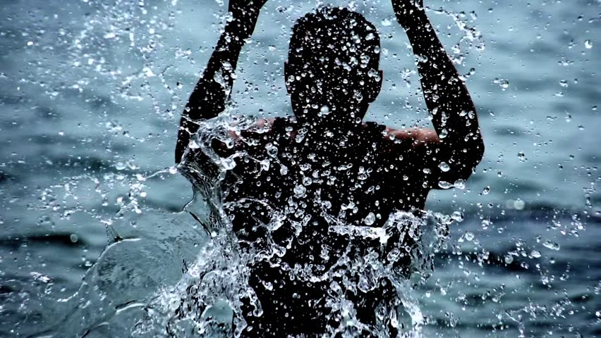 man at beach. slow motion. silhouette of male person. water splash. splashing. fresh sports activity. leisure recreational Royalty-Free Stock Footage #3493223