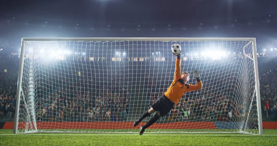 Soccer goalkeeper jumps and saves ball on a professional soccer stadium. Stadium and crowd is made in 3D and animated