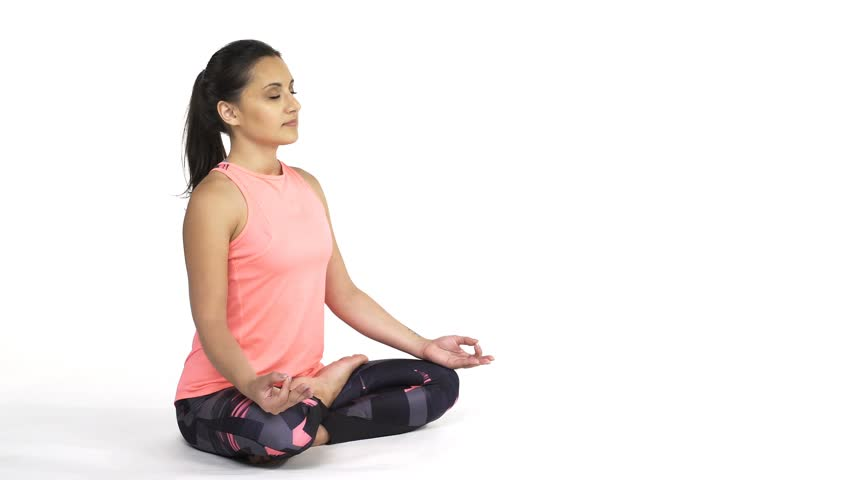 Young attractive woman practicing yoga, doing Padmasana, lotus pose in full length, isolated over white studio background   Shutterstock HD Video #34963948