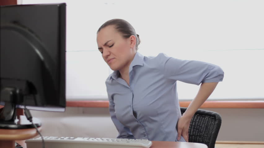Young business woman with back pain