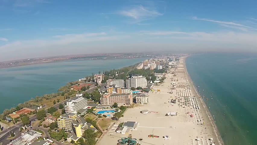 Aerial presentation of the main strip of Mamaia holiday resort area, a top travel destination in summer , on the Black Sea Coast , Romania. | Shutterstock HD Video #34965478
