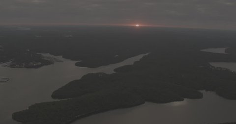Aerial footage over Lake of the Ozarks; Sunrise or sunset