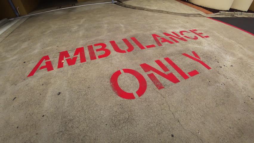 Ambulance POV as it stops in emergency bay at public hospital.