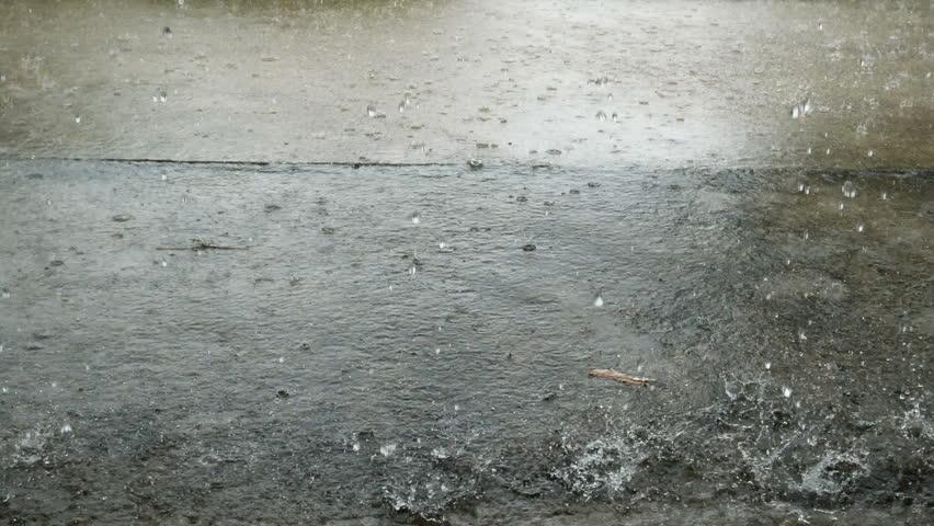 Closeup shot of heavy rain on road | Shutterstock HD Video #34985698