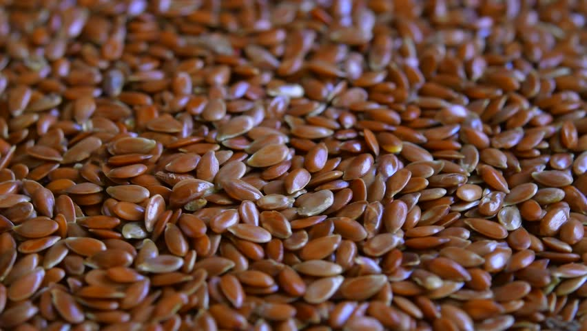 Flax seeds background. rotating | Shutterstock HD Video #34993471