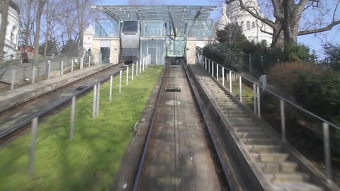 Funicular cable car at Montmartre in Paris with Basilica du Sacre Coeur in background