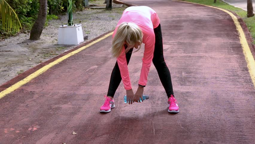 Fitness woman stretching her muscles before training, ready for jogging in summer park. Healthy lifestyle and sport concept | Shutterstock HD Video #34994476