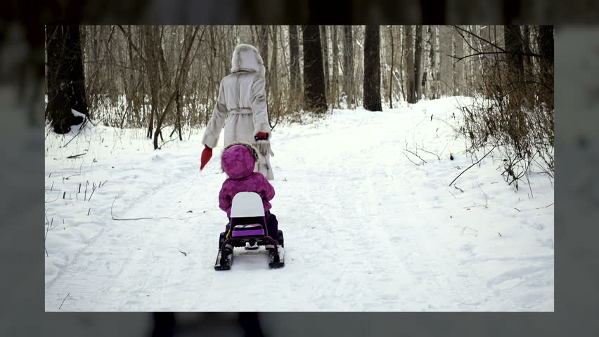 Family concept, mom and child. European or american woman and 4-5 years girl in winter forest, montage representatives on 3D cube.  | Shutterstock HD Video #35013352