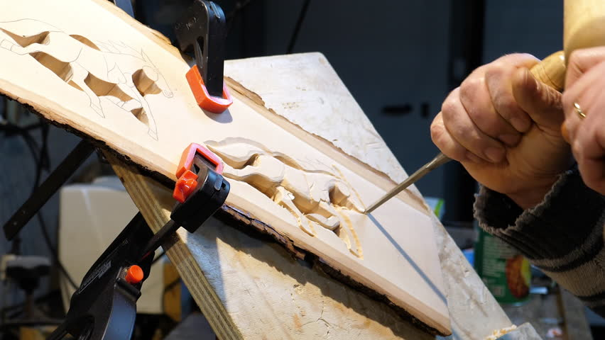 Wood Carver with chisel and hammer.   Shutterstock HD Video #35025991