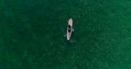 Aerial footage of people who are surfing. Surfers, students. Malibu Beach. California. May 2018. 4K slow motion video. Drone. View from the top.