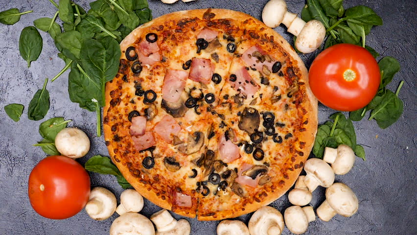 Slow motion top view of hands seasoning pizza with mushrooms | Shutterstock HD Video #35032873