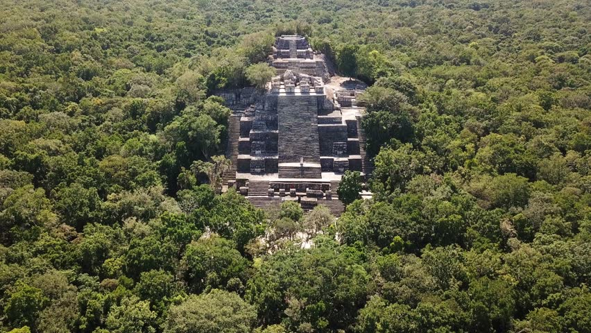 Aerial video flying towards the mayan Calakmul Temple in the Mexican Yucatan. The mayan ruins at Calakmul, Mexico