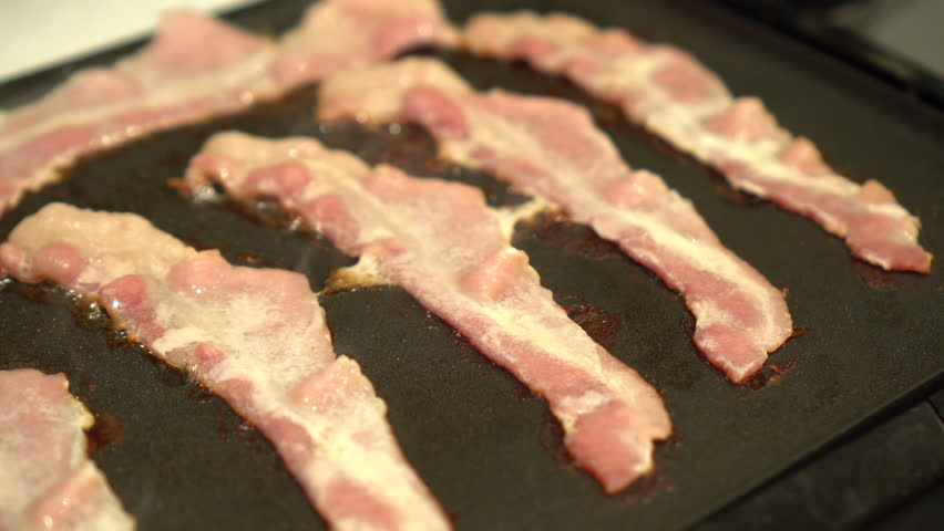 Bacon cooking on Griddle | Shutterstock HD Video #35046421