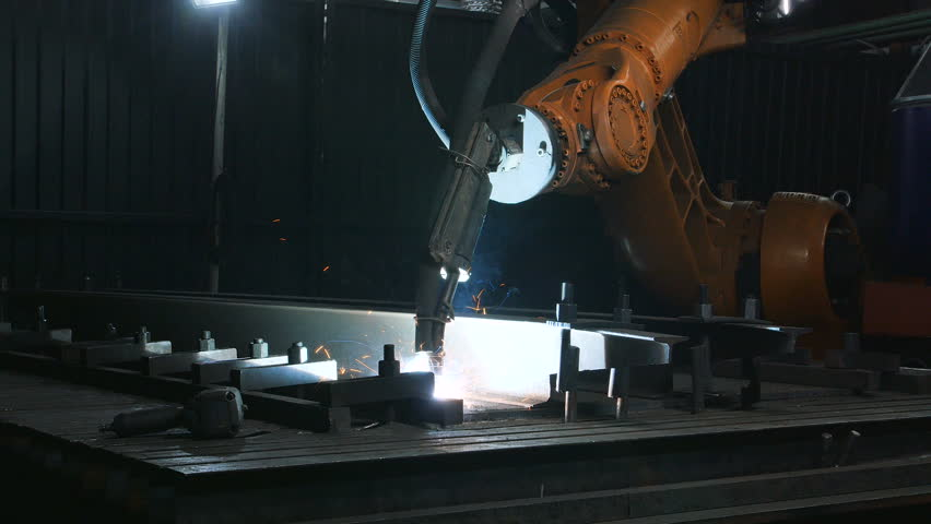 Timelapse of welding robot arm melt metal process at workshop. High Precision Modern Tools in Heavy Industry. Automatic work. Technology and Industrial Concept. Shot in 5K RAW