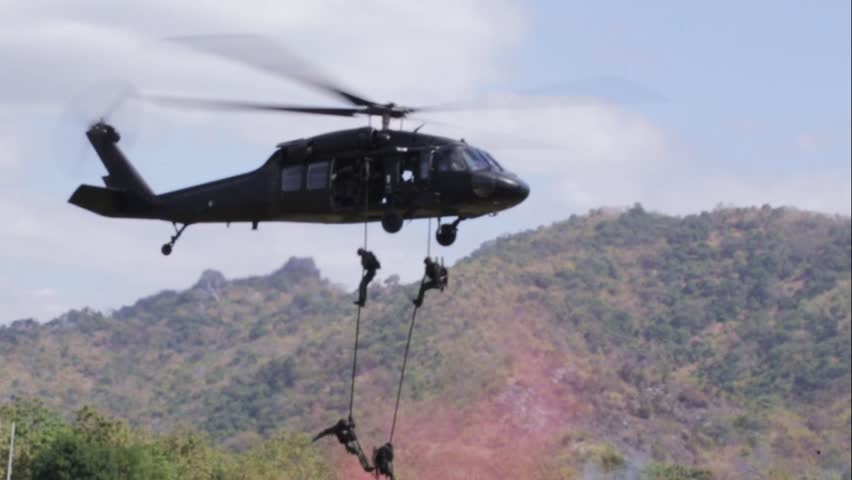 Soldiers sprang from the helicopter.