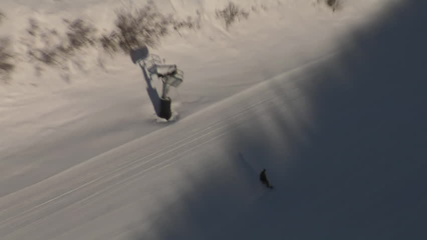Aerial shot of skiers entering shadow | Shutterstock HD Video #3508043