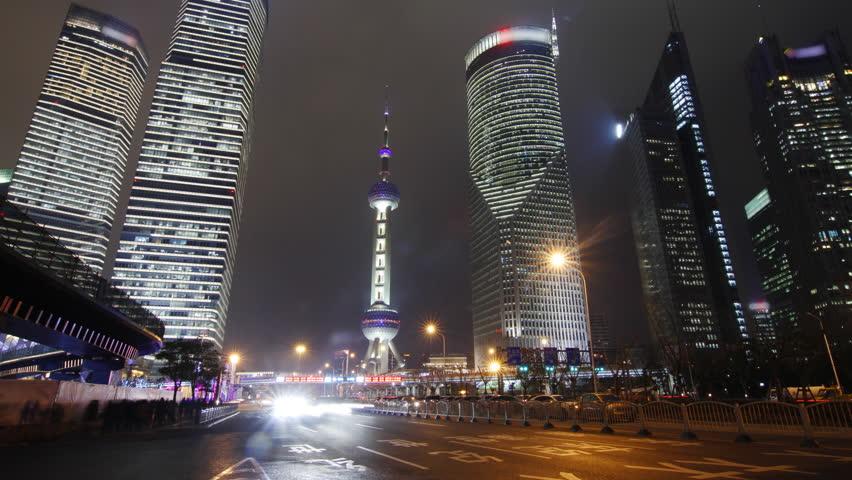 Shanghai landmark and city traffic at night - Shanghai, China.