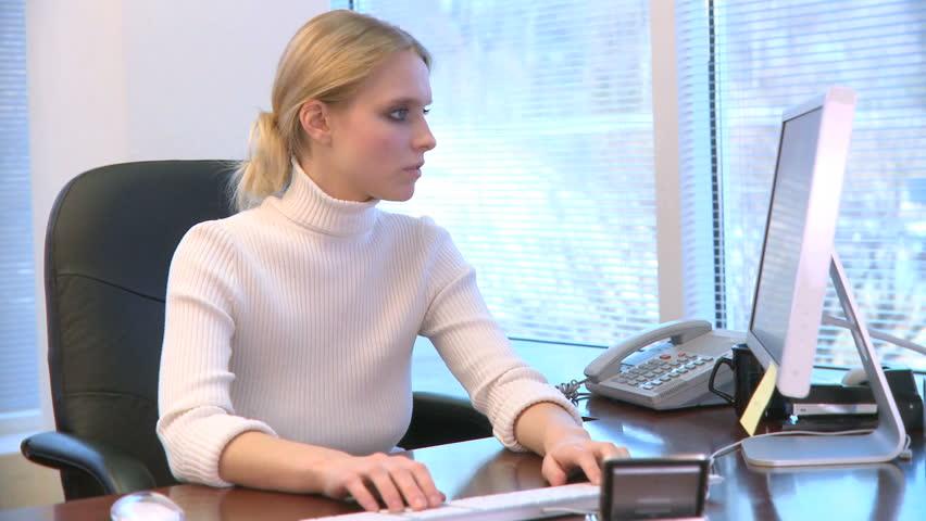 A Professional Woman in an Office | Shutterstock HD Video #352547