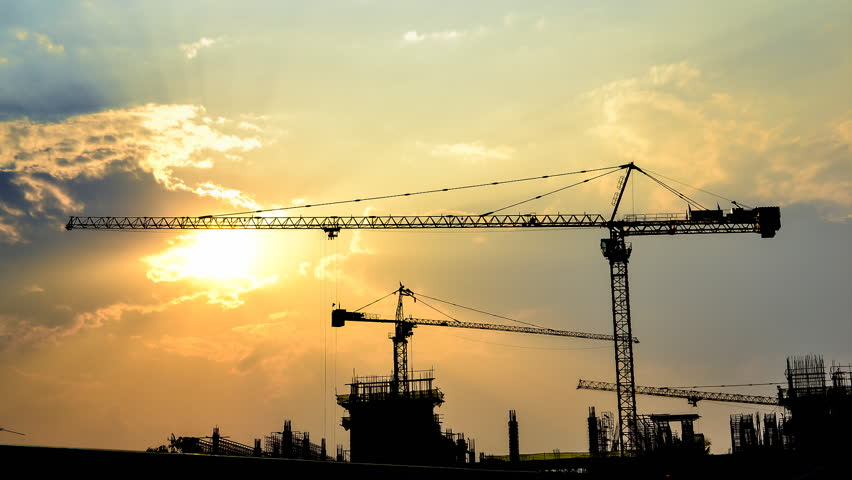 Time lapse sunset and silhouette crane working in construction site | Shutterstock HD Video #3528413