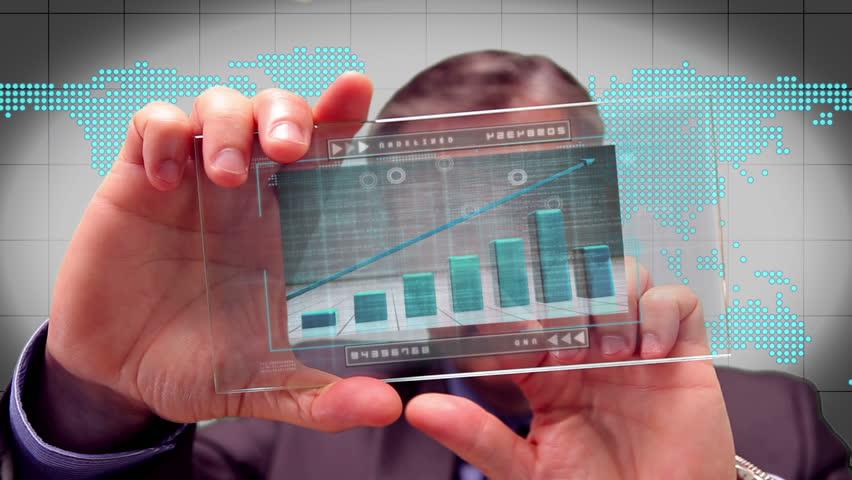 Businessman using futuristic touchscreen to see graph | Shutterstock HD Video #3531587