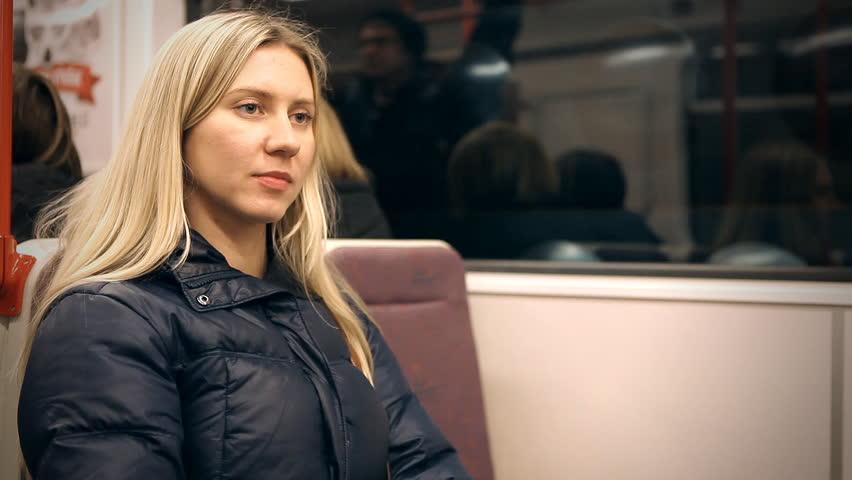 Beautiful young woman sits in subway | Shutterstock HD Video #3542942