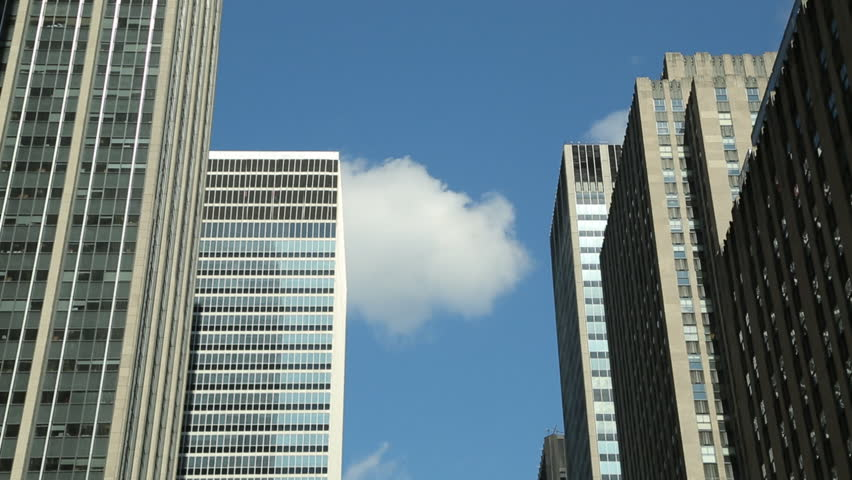 Tall buildings in a city time-lapse    Shutterstock HD Video #3553304