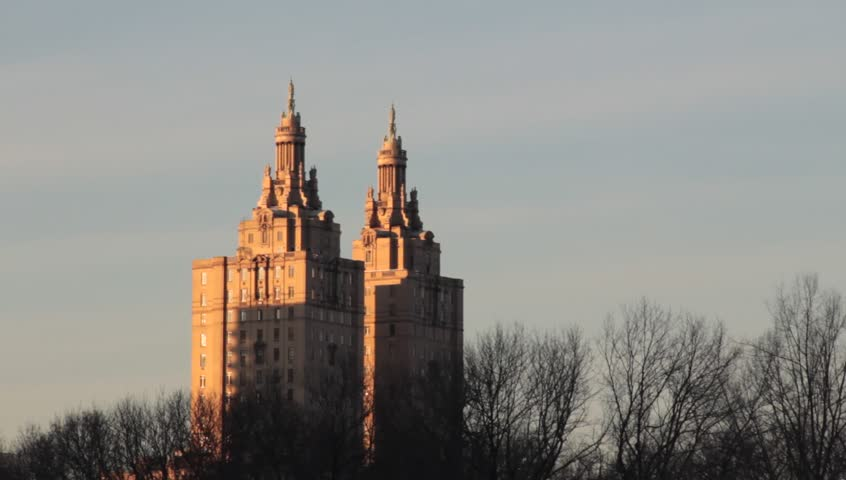 New York, NY - Circa 2012: A view of twin apartment buildings in new york city as seen from a snow covered central park at dusk   Shutterstock HD Video #3556703