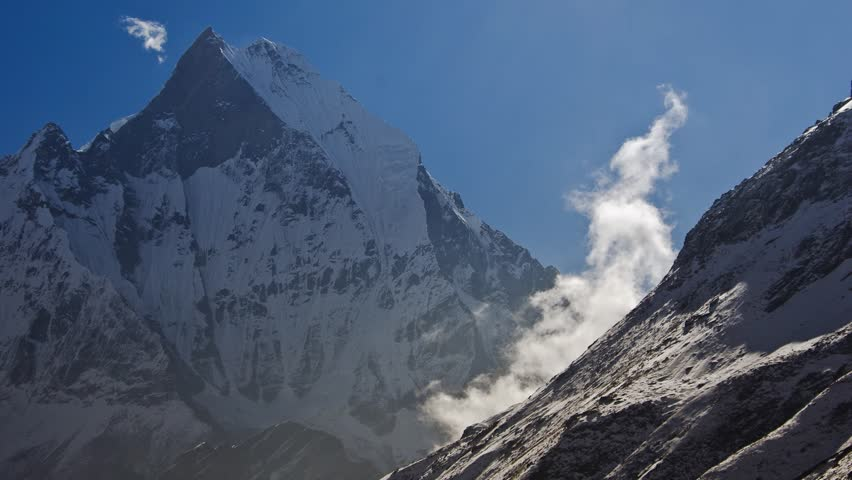 Clouds forming near the Machapuchare peak in the Annapurna region of the Himalayas on the way to the Annapurna Base Camp (time lapse/timelapse)