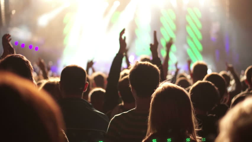 Shot of some cheering fans at a life concert, slow motion, some visible noise due high ISO, soft focus, also normal speed version of this video available in my portfolio | Shutterstock HD Video #3568565