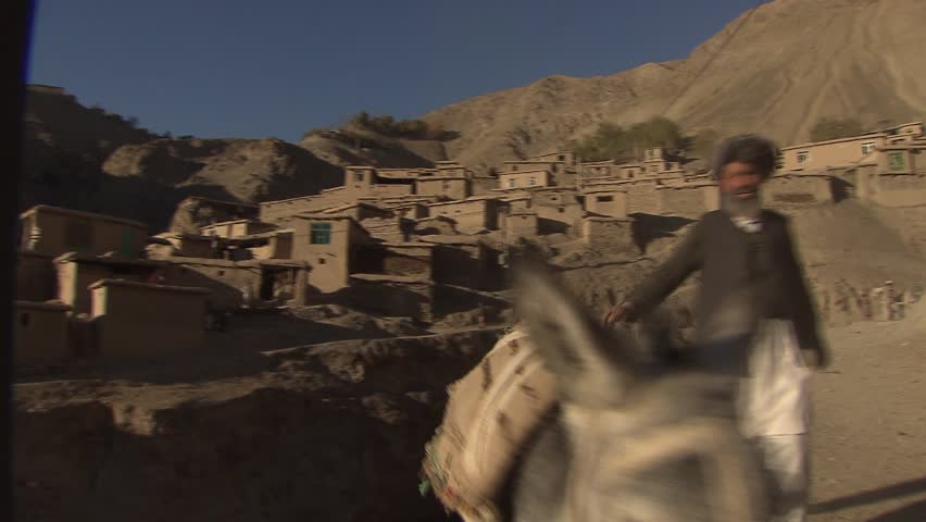 UPPER YAFTAL, AFGHANISTAN - NOVEMBER 23: Children and donkey in a remote mountain village in northeastern Afghanistan on November 23, 2011.