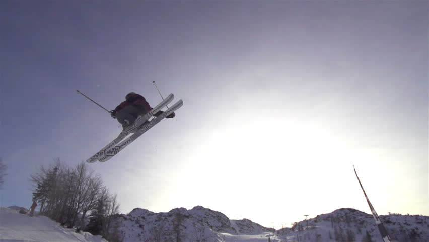 SLOW MOTION: freestyle skier jumping