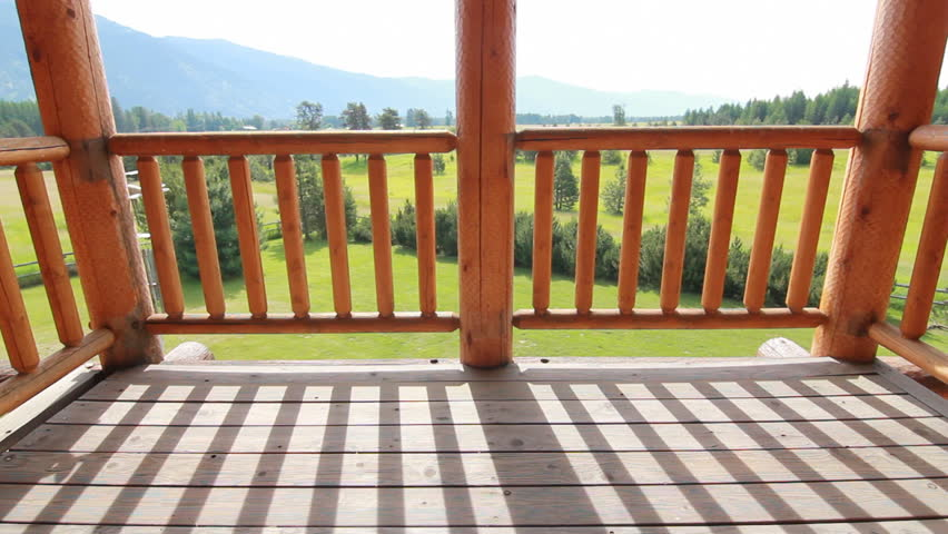 Log home balcony reveal green field with mountains and trees | Shutterstock HD Video #3587543