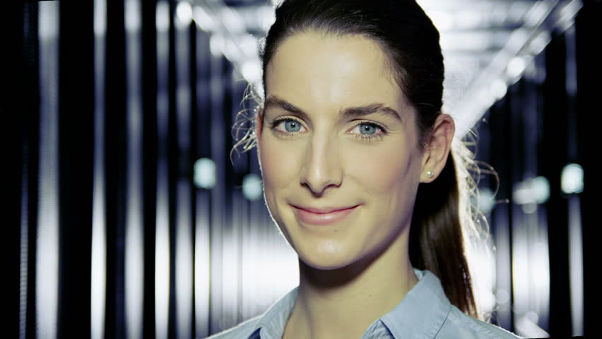 Portrait of a female IT engineer who is working in a data center with rows of server racks and computers.  | Shutterstock HD Video #3589277